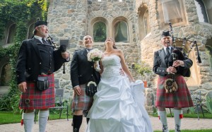 Julie and Michael at Dunafon Castle with Randy Arent and Ian Jackson, Bagpipers.  Photo courtesy of Terry Tuske
